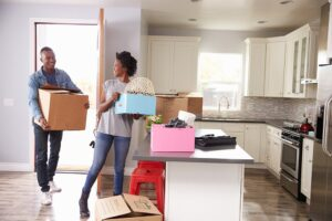 decorative image of a couple moving boxes