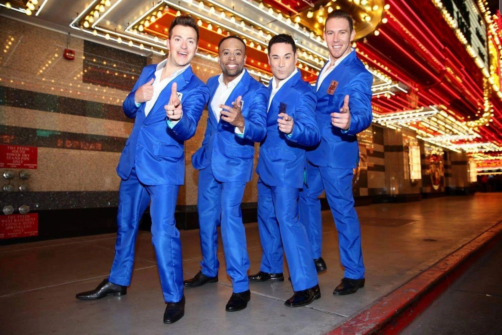 decorative image of four men in blue suits